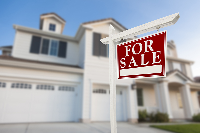 For Sale Real Estate Sign in Front of Beautiful New House Before Home Inspection Services Are Preformed