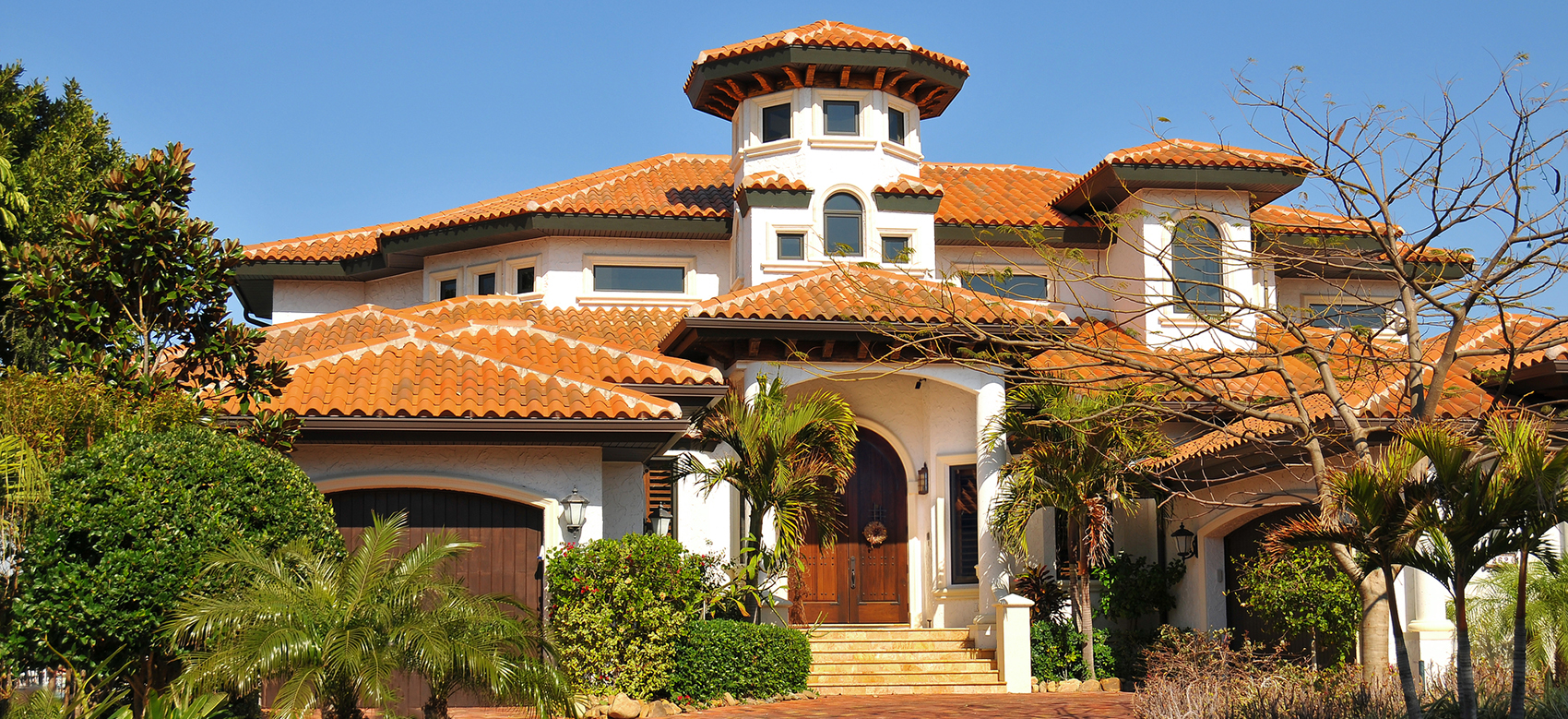 Luxury spanish style home with tiles roofs in Florida